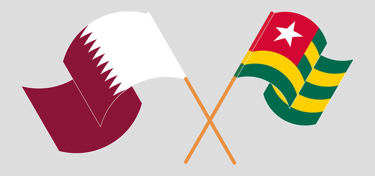 Crossed and waving flags of Qatar and Togo