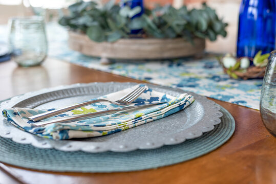 Stylish spring table place setting in blue and green