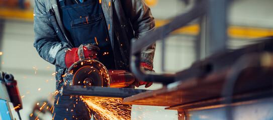 Fototapeta Man working with electric grinder tool obraz
