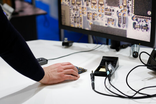 engineer using a digital microscope for inspection