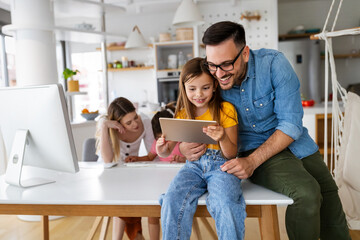 Online school, technology, family concept. Happy parents helping to children to study at home