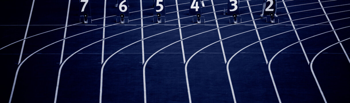 Starting blocks in track and field. Professional sport concept. Blue color filter