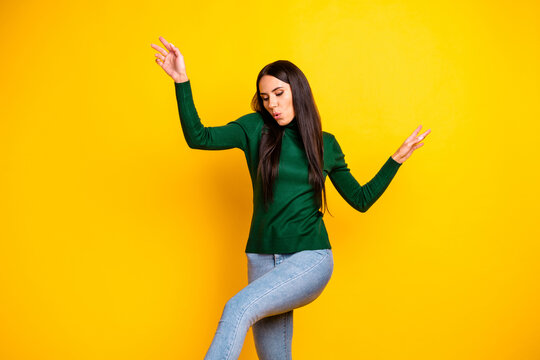 Photo of young charming positive lovely pretty girl dancing enjoying fee time weekend isolated on yellow color background