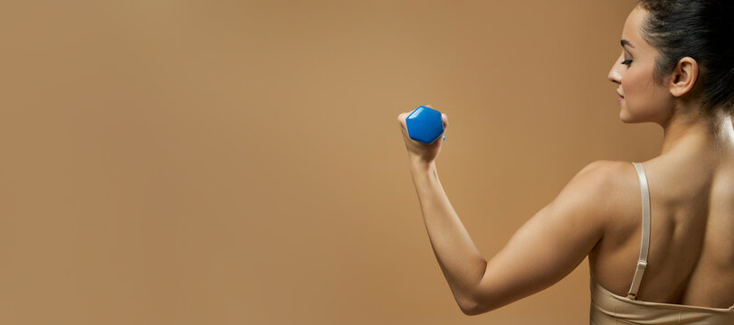 Website header of Athletic young woman doing exercise with dumbbell
