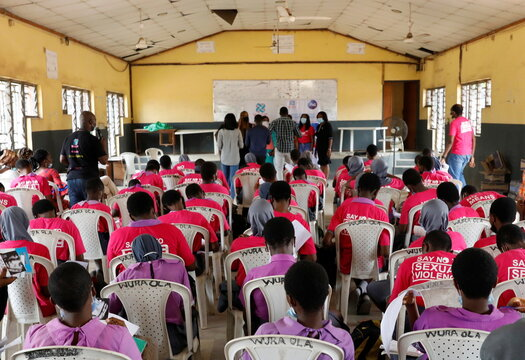Students are seen in a school hall as they receive lectures about prevention of sexual violence, by a representative of Women at Risk International Foundation (WARIF) at Oregun High School, in Lagos