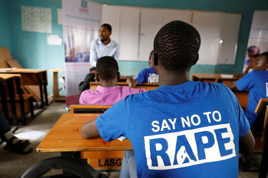 Students are seen in a classroom as they receive lectures about prevention of sexual violence, by a representative of Women at Risk International Foundation (WARIF) at Oregun High School, in Lagos