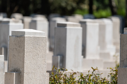 Many tombs in rows, graves on military  cemetery