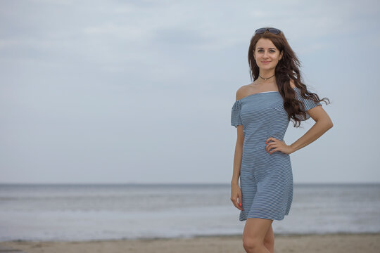 beautiful happy adult woman early morning on the beach