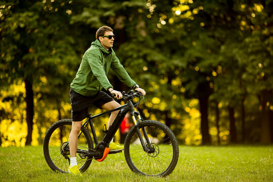 Young man riding ebike in the park