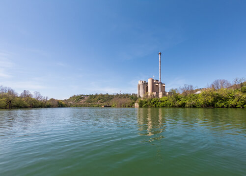 Industrial power station on the banks of the Monongahela river on a calm spring day in Morgantown, West Virginia