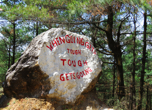 Rock painting In the Roadside, Positive energy to the traveler,  When Going Gets Tough  Tough  Gets Going. the positive message of encouragement.