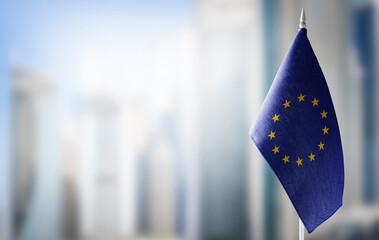 Fototapeta Small national flags of the European Union on a light blurry background obraz