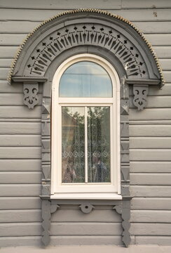 Window of a wooden country house decorated with wood carvings