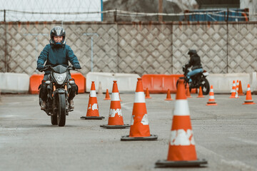 motorcycle driving school. a woman learns to drive before obtaining a driving license.
