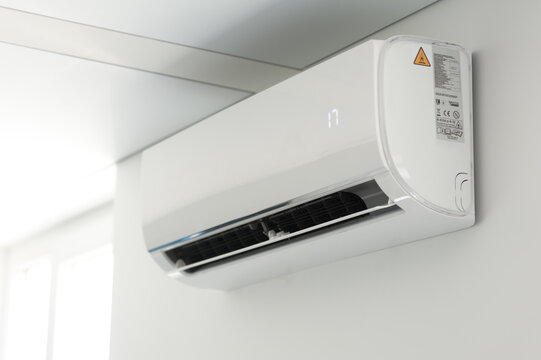 A new air conditioner unit on the white wall