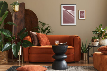 Domestic interior of living room with design sofa, mock up poster frames, a lot of plants, coffee...