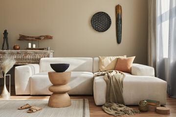 Stylish ethnic living room interior with design modular sofa, wooden stool, moroccan shelf, carpet...