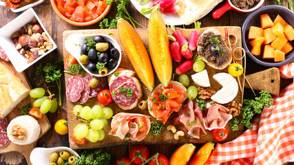 antipasto platter with ham, salami, cheese and melon