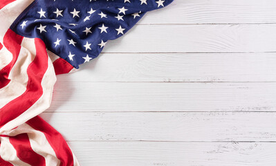 Fototapeta Happy memorial day concept made from vintage american flag on white wooden background. obraz