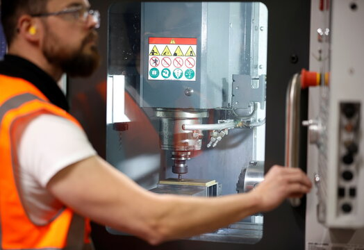 A worker operates a CNC milling machine inside the Naylor Industries Wombwell site in Wombwell