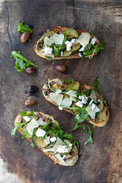 Vegetarian bruschette with olives and courgettes