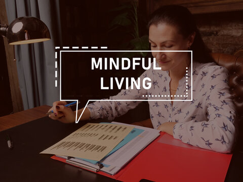 MINDFUL LIVING phrase on the screen. Broker analyzing market research results.