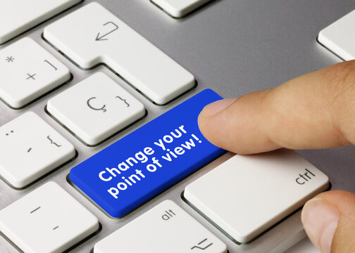 Change your point of view! -  Inscription on Blue Keyboard Key.