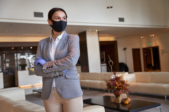 Beautiful woman in elegant suit standing in the hotel lobby