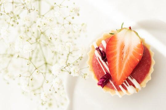 selection of sweet baked cream edible flowers and fruit dessert cakes for mothersday, wedding, birthday, paerty celebration. viola odorata cake.