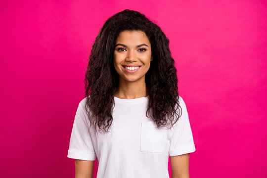 Portrait of attractive cheerful girl wearing white tshirt isolated over vivid fuchsia color background