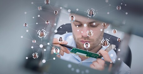 Fototapeta Network of connected bubbles with diverse faces, over caucasian man holding pcb board obraz