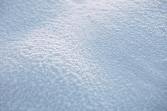 Beautiful texture of snow. Beautiful sunlight shows the texture and details of the snow