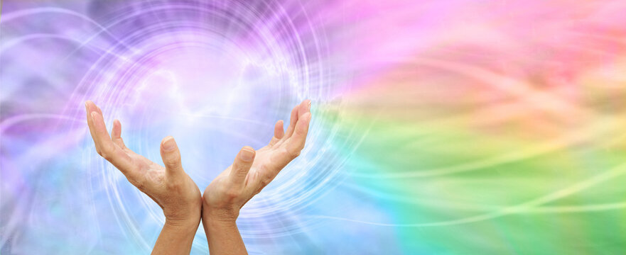 Healing Rainbow Vortex Energy Phenomenon Message Banner - female open hands reaching up within a vortex of energy on a  rainbow coloured flowing background and space for copy on right