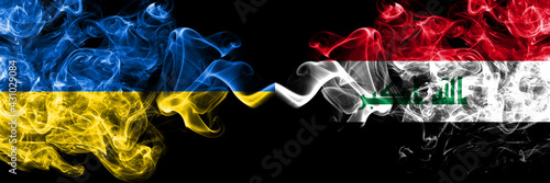 Ukraine, Ukrainian vs Iraq smoky mystic flags placed side by side. Thick colored silky abstract smokes flags.