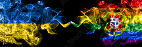 Ukraine, Ukrainian vs Portugal, Portuguese, gay, pride  smoky mystic flags placed side by side. Thick colored silky abstract smokes flags.
