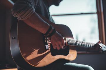 Fototapeta Musician playing on acoustic guitar obraz