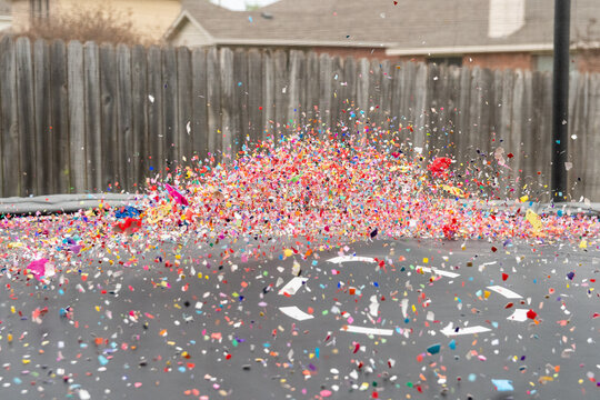 Colorful confetti flying in the air over trampolene