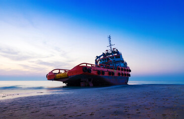 Ship Wreck along the Umm Al Quwain Coast in UAE. A stranded or abandoned vessel on the beach. Long Exposure Shot.