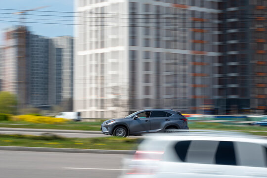 Ukraine, Kyiv - 30 April 2021: Gray Lexus NX car moving on the street. Editorial