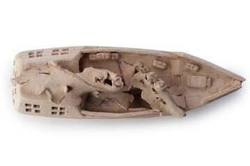 Sunken old ship isolated on white background. Decorative clay ship for the aquarium.