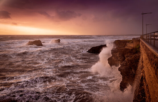 Stormy pink sunset in french west coast while strong wind, rain and heavy sea