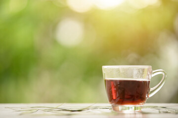 Hot tea on green background