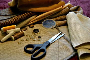 Fototapeta Zdjęcie przedstawiające tkaniny dekoracyjne z dodatkami krawieckimi obraz
