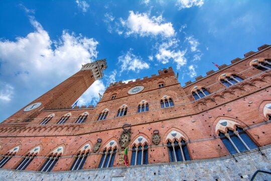 Piazza del Campo with The Torre del Mangia tower in Siena.