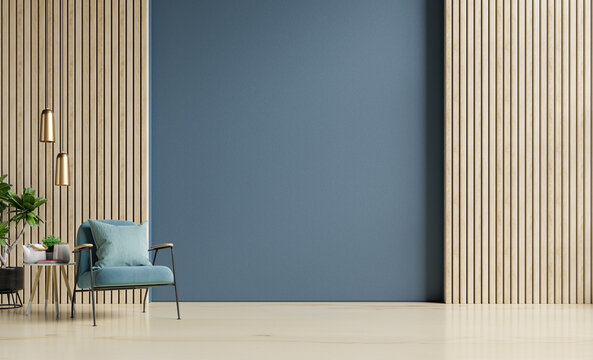 Stylish Modern wooden living room has an armchair on empty dark blue wall background.