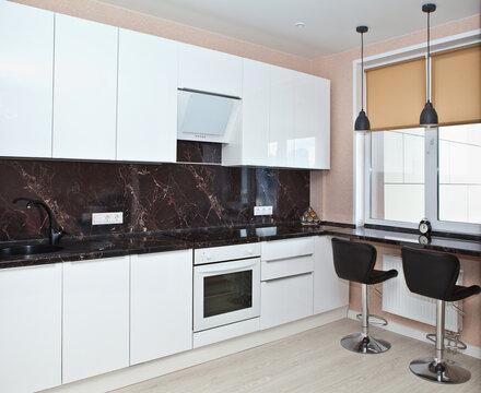 Modern kitchen interior with bar stools