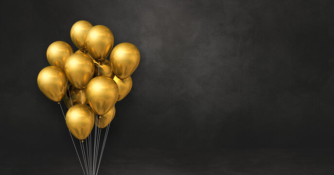 Gold balloons bunch on a black wall background. Horizontal banner.