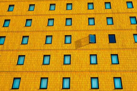 windows of a building on a sunny day  near Takachiho