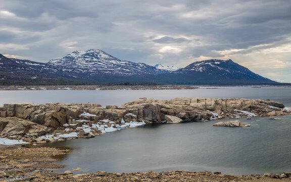 Landscape with the reservoir Akkajaure and mountains in Sarek National Park under overcast sky, Lapland, Sweden.