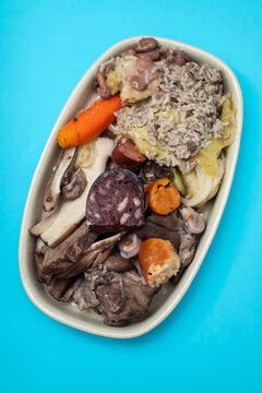 typical portuguese dish meat, smoked sausages and vegetables on the dish